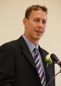 A man speaking at a podium.